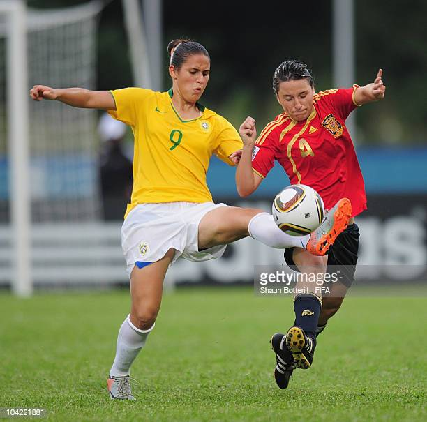 Paula of Brazil is challenged by Ivana Andres of Spain during the FIFA U17 Women's World Cup Quarter Final match between Spain and Brazil at the Ato...