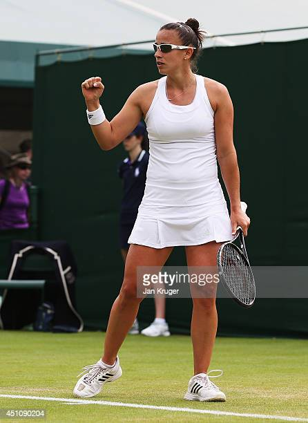 Paula Ormaechea of Argentina reacts during her Ladies' Singles first round match against Polona Hercog of Slovenia on day one of the Wimbledon Lawn...