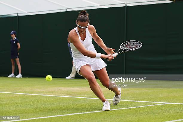 Paula Ormaechea of Argentina returns a shot during her Ladies' Singles first round match against Polona Hercog of Slovenia on day one of the...