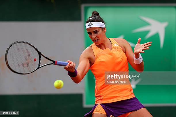 Paula Ormaechea of Argentina returns a shot in her women's singles match against Romina Oprandi of Switzerland on day two of the French Open at...
