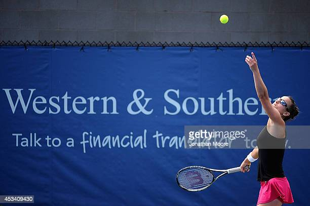 Paula Ormaechea of Argentina serves to Polona Hercog of Slovenia during a match on day 1 of the Western and Southern Open on August 9 2014 in...