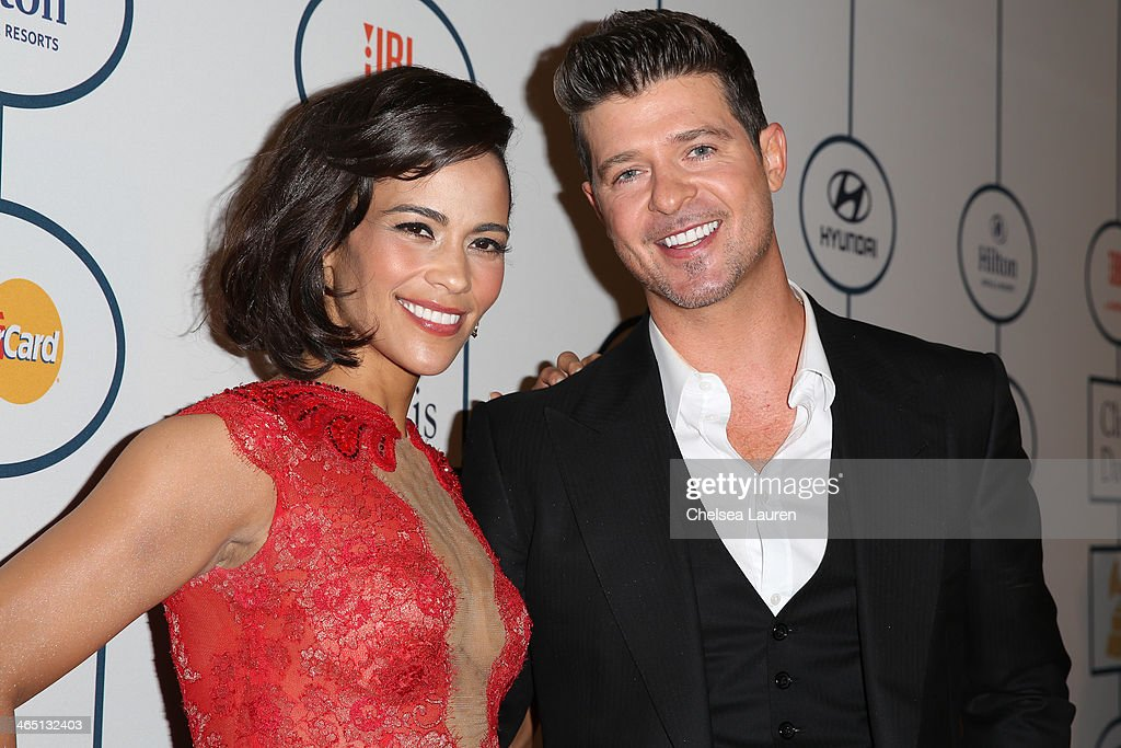 Paula Patton (L) and singer Robin Thicke arrive at the 2014 HYUNDAI / GRAMMYs Clive Davis Pre-GRAMMY Gala Activation + Equus Fleet Arrivals at The Beverly Hilton Hotel on January 25, 2014 in Beverly Hills, California.