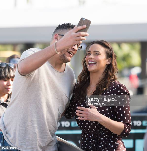 Paula Patton takes a selfie with a fan at 'Extra' at Universal Studios Hollywood on January 10 2018 in Universal City California