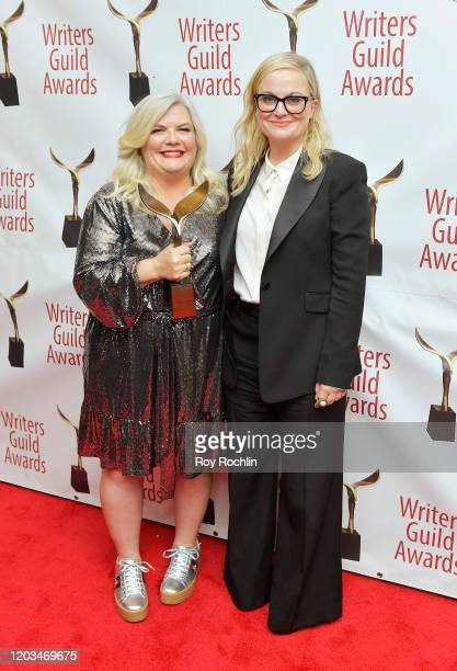 Paula Pell and Amy Poehler pose backstage at the 72nd Writers Guild Awards at Edison Ballroom on February 01 2020 in New York City