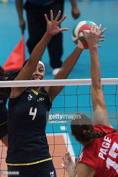 Paula Pequeno from Brazil block the shot of Brittney Page from Canada in the volleyball women's during the 2011 XVI Pan American Games at Pan...