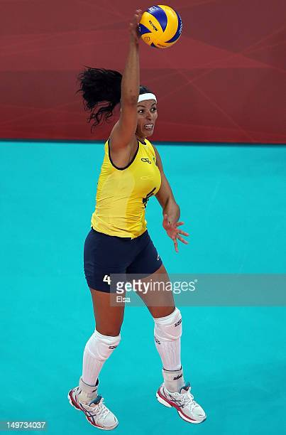 Paula Pequeno of Brazil sends the ball over the net in the first set against China during Women's Volleyball on Day 7 of the London 2012 Olympic...