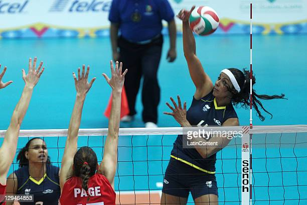 Paula Pequeno shot over the from Brazil shot over Canada block in the volleyball women's during the 2011 XVI Pan American Games at Pan American...