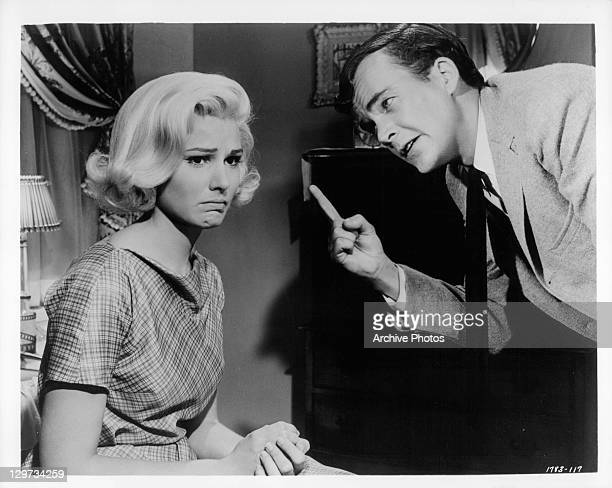 Paula Prentiss gets lectured by Jim Hutton after she dyes her hair blonde in a scene from the film 'Bachelor In Paradise' 1961