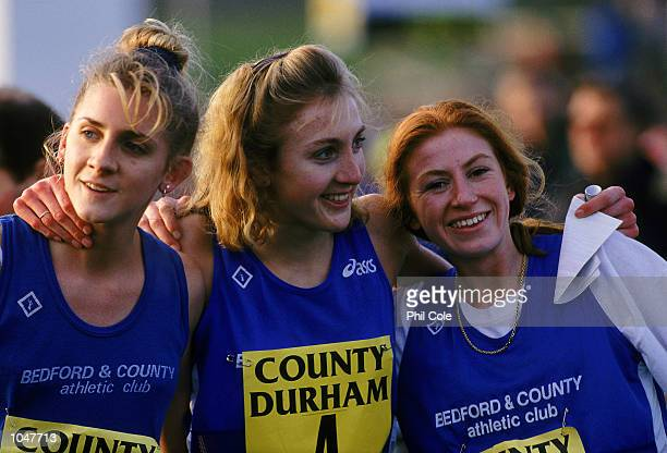 Paula Radcliffe of Bedford and County Athletics Club celebrates with fellow teammates Liz Talbot and Michelle Mathews after completing the Durham...