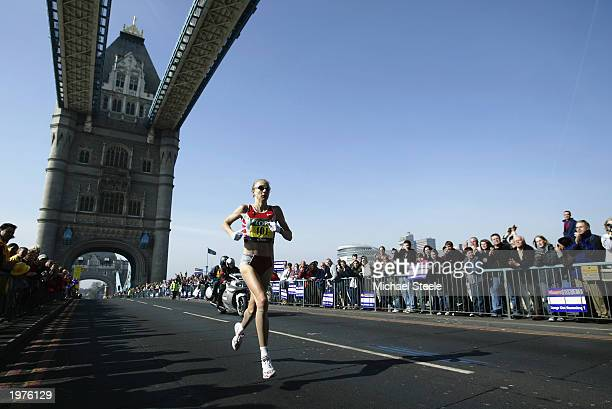 Paula Radcliffe of England at the halfway point as she crosses Tower Bridge during the 2003 Flora London Marathon on April 13 2003 at the Mall in...