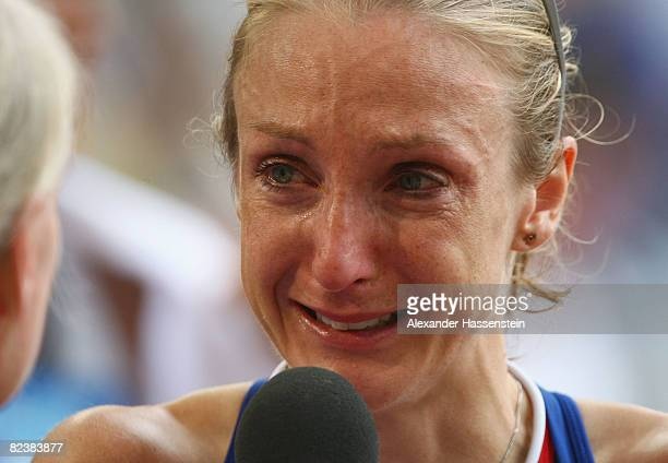 Paula Radcliffe of Great Britain breaks down in tears as she is interviewed after the Women's Marathon Final held at the National Stadium on Day 9 of...