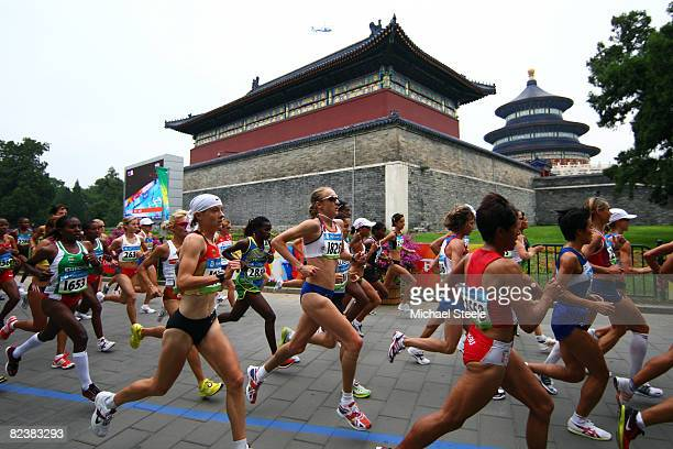 Paula Radcliffe of Great Britain competes in the Womens Marathon which began at Tiananmen Square and will finish at the National Stadium on Day 9 of...