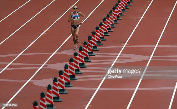 Paula Radcliffe of Great Britain completes her final lap in the Women's Marathon Final held at the National Stadium on Day 9 of the Beijing 2008...