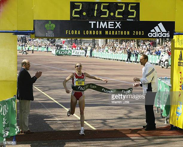 Paula Radcliffe of Great Britain crosses the line to win the 2003 Flora London Marathon on April 13 2003 at the Mall in London England