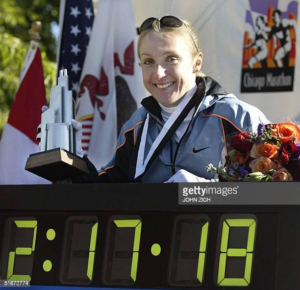 Paula Radcliffe of Great Britain holds her trophy after winning the Chicago Marathon 13 October 2002 Radcliffe's time of 21718 set a new world record...