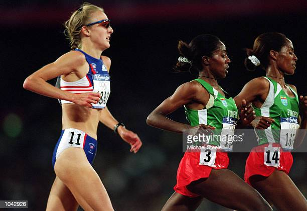 Paula Radcliffe of Great Britain is overtaken by Derartu Tulu and Gete Wami of Ethiopia in the 10000 metres Final at the Olympic Stadium on Day...