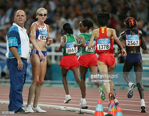 Paula Radcliffe of Great Britain looks dejected after she pulled out of the women's 10000 metre event on August 27 2004 during the Athens 2004 Summer...