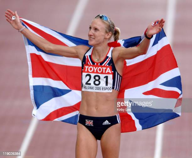 Paula Radcliffe of Great Britain takes a victory lap with a British flag after winning the women's marathon in 22057 in the IAAF World Championships...