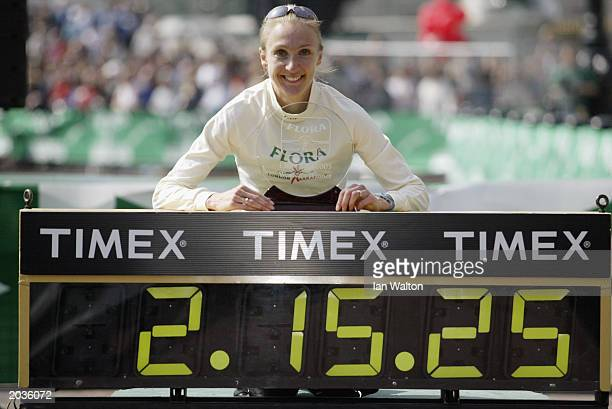 Paula Radcliffe of Great Britain with the womens elite trophy after winning the 2003 Flora London Marathon on April 13, 2003 at the Mall, in London,...