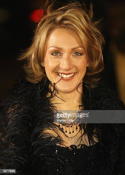 Paula Radcliffe poses as she arrives for the BBC Sports Personality of the Year Awards held at the BBC Television Centre in London December 8 2002