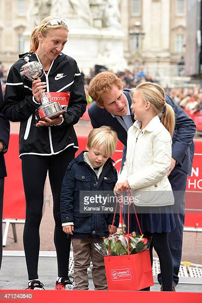 Paula Radcliffe with her family receives the inaugural John Disley London Marathon Lifetime Achievement Award from Prince Harry during the Virgin...