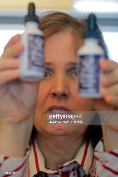 Paula Rocha who suffers epileptic seizures holds Cannabidiol jars a nonpsychoactive marijuana derivative in liquid form that she uses to improve her...