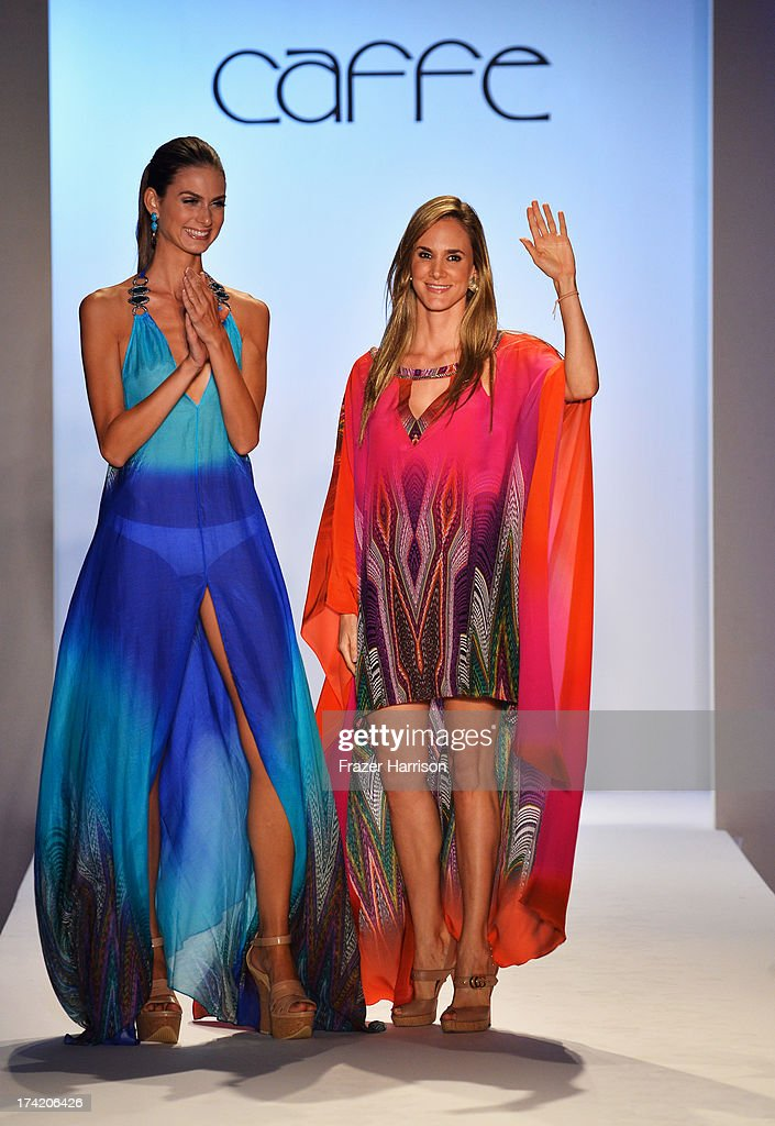 Paula Saavedra (R) walks the runway at the Caffe Swimwear show during Mercedes-Benz Fashion Week Swim 2014 at Oasis at the Raleigh on July 21, 2013 in Miami, Florida.