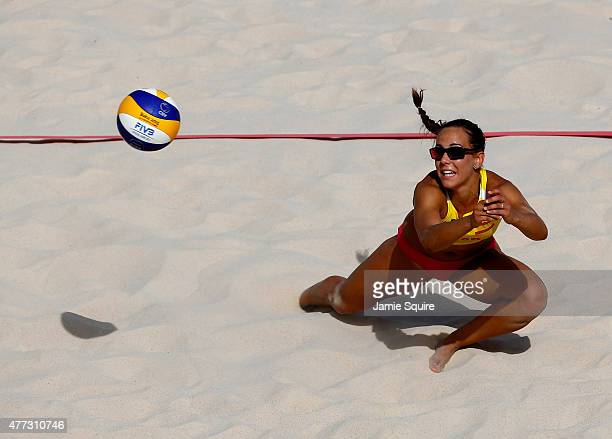 Paula Soria Gutierrez of Spain lunges for a ball as she competes in the Women's beach volleyball preliminary match against Norway during day four of...