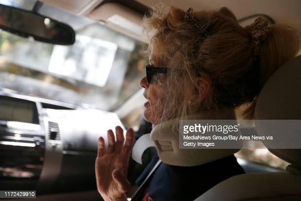 Paula Thompson is driven home by a volunteer from the Get Up Go paratransit service after a physical therapy appoint on Tuesday July 11 in San Mateo...