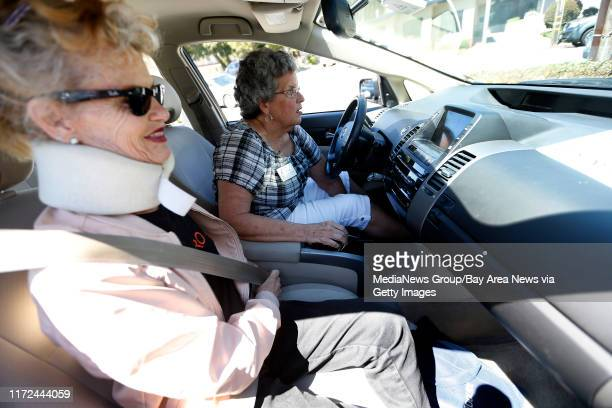 Paula Thompson left gets into a car driven by volunteer Barbara Saunders right from the Get Up Go paratransit service after a physical therapy...