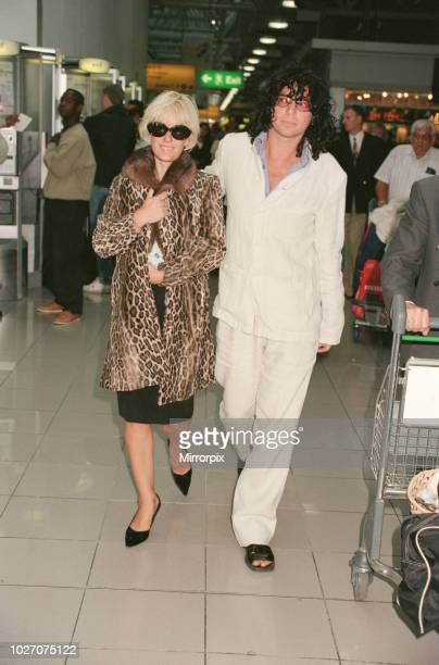 Paula Yates and her boyfriend, INXS singer Michael Hutchence leave Heathrow Airport for Hong Kong. Paula is holding their daughter Heavenly Hiraani...