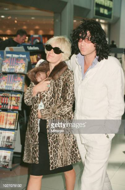 Paula Yates and her boyfriend INXS singer Michael Hutchence leave Heathrow Airport for Hong Kong Paula is holding their daughter Heavenly Hiraani...