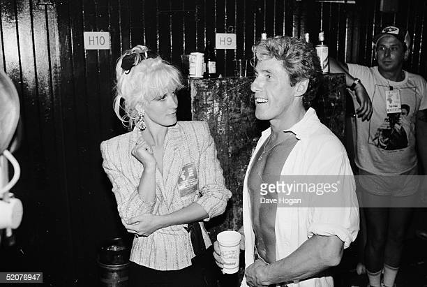 Paula Yates chats with Roger Daltrey backstage at Wembley Stadium during the Live Aid Concert 13th July 1985