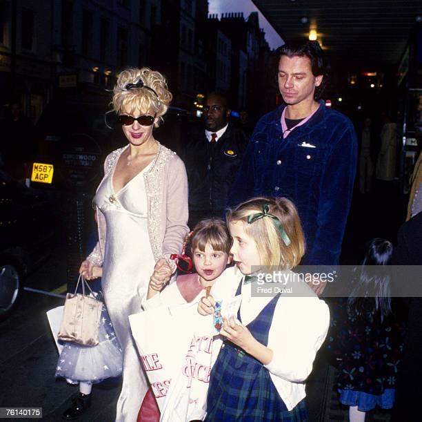 Paula Yates, Michael Hutchence, and her three children with Bob Geldof, Fifi Trixibelle, Peaches Honeyblossom and Pixie.