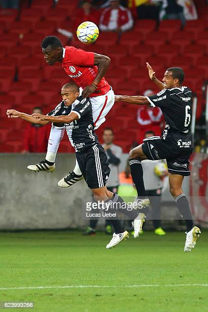 Paulao of Internacional battles for the ball against Nino Paraiba of Ponte Preta during the match between Internacional and Ponte Preta as part of...