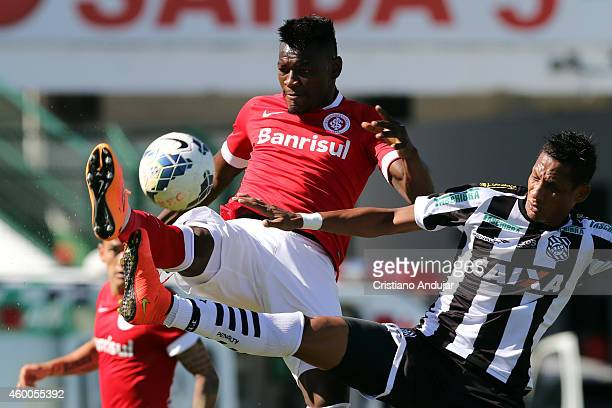 Paulao of Internacional take the ball before Marcao of Figueirense during a match between Figueirense and Internacional as part of Campeonato...