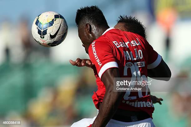 Paulao of Internacional wins header with Marcao of Figueirense during a match between Figueirense and Internacional as part of Campeonato Brasileiro...