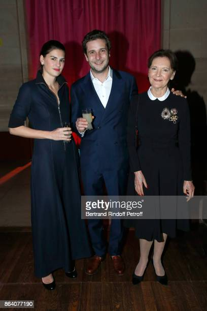 PaulCharles Ricard standing between his wife Alice and Daniele Ricard attend the 'Bal Jaune Elastique 2017' Dinner Party at Palais Brongniart during...