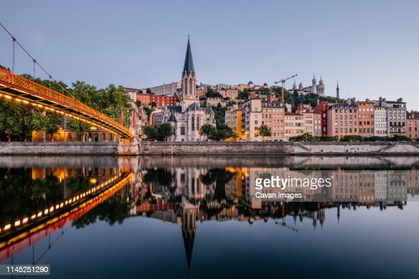 paul-couturier footbridge over saone river against buildings in city during sunset - lyon photos et images de collection