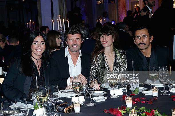 PaulEmmanuel Reiffers and his wife Margaux actress Lou Doillon and Stylist Haider Ackermann attend the Annual Charity Dinner hosted by the AEM...