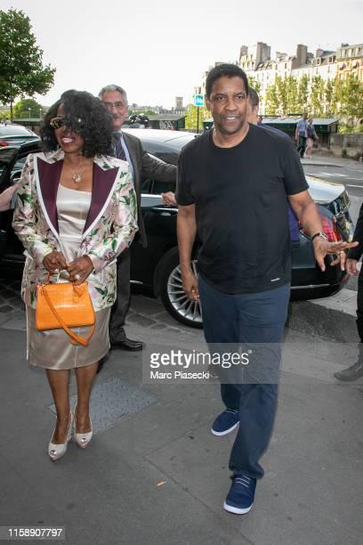 Pauletta Washington and Denzel Washington arrive at 'Laperouse' restaurant on June 28, 2019 in Paris, France.