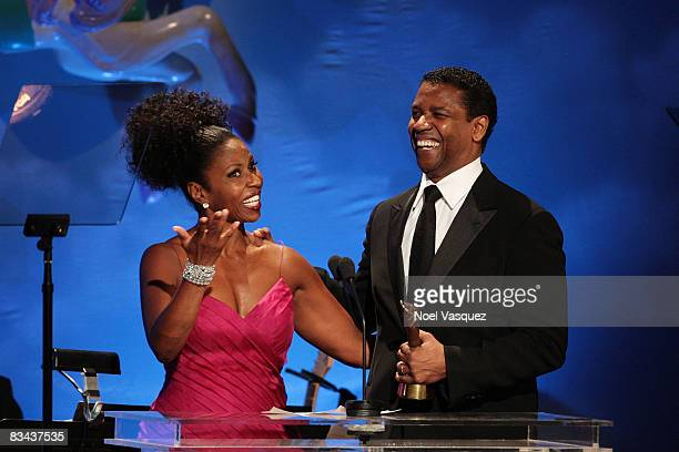 Pauletta Washington and Denzel Washington speak on stage at the 30th Anniversary Carousel Of Hope Ball at The Beverly Hilton Hotel on October 25,...