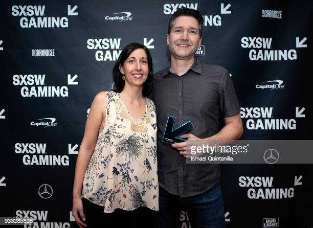 Paulette Denman and Stu Denman pose with the Gamer's Voice Award Mobile Game backstage at SXSW Gaming Awards during SXSW at Hilton Austin Downtown on...