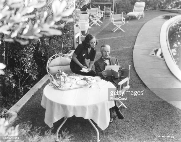 Paulette Goddard and Charlie Chaplin at home Hollywood California April 1937