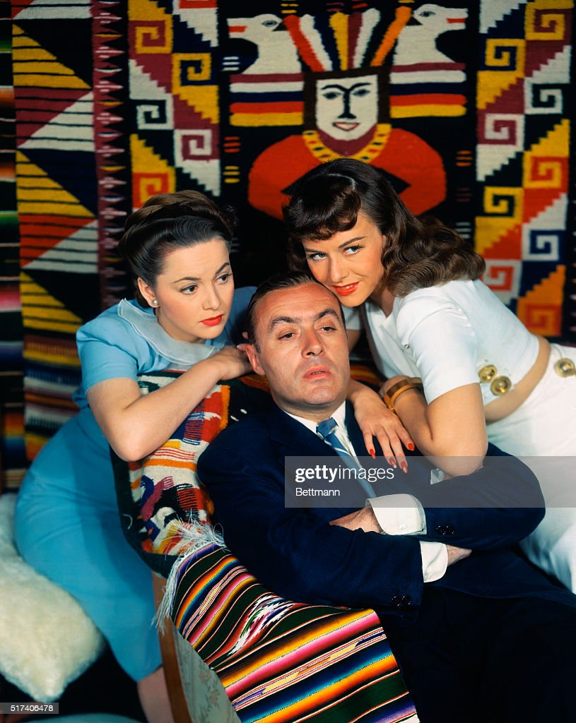 Charles Boyer with Olivia De Havilland and Paulette Goddard : News Photo