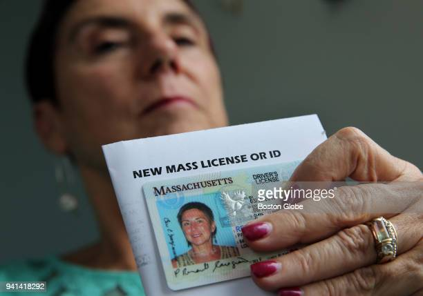 Paulette RenaultCaragianes displays her new drivers license at her office in Lowell MA on March 29 2018 She is disappointed that the RMV induced her...