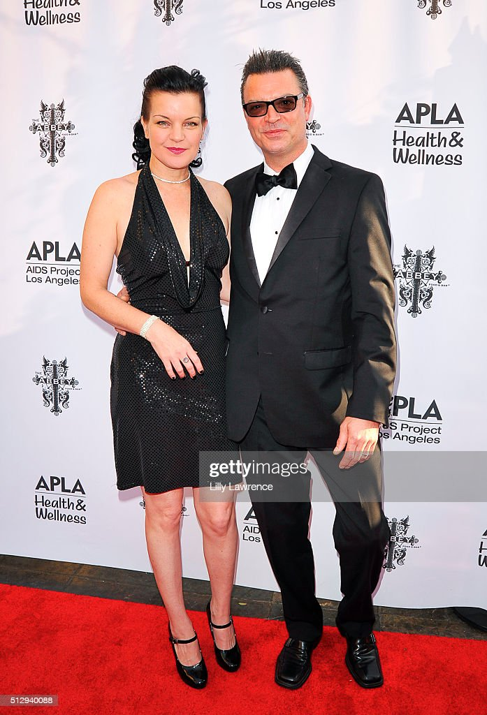 Pauley Perrette and fiance Thomas Arklie attend The Abbey Food And Bar's 15th Annual 'The Envelope Please' Oscar viewing party at The Abbey on February 28, 2016 in West Hollywood, California.