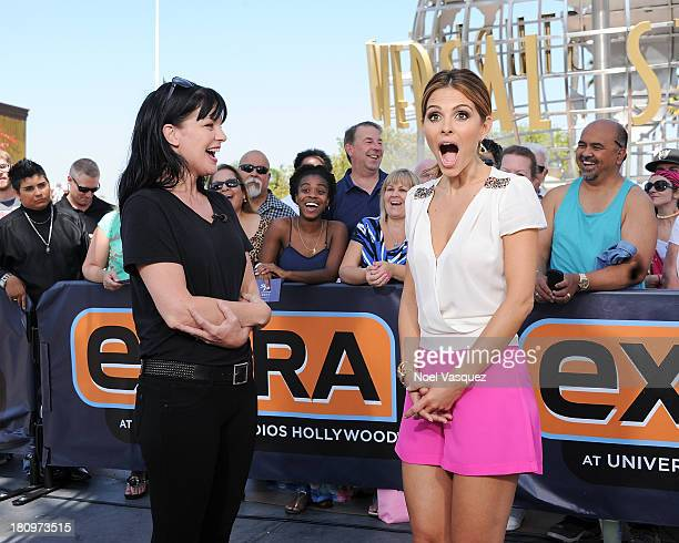Pauley Perrette and Maria Menounos visit 'Extra' at Universal Studios Hollywood on September 18 2013 in Universal City California