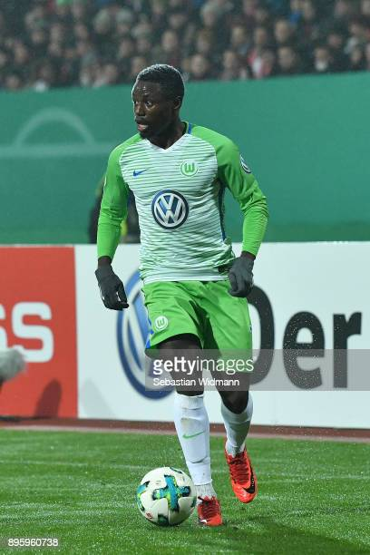 PaulGeorge Ntep of Wolfsburg plays the ball during the DFB Cup match between 1 FC Nuernberg and VfL Wolfsburg at MaxMorlockStadion on December 19...