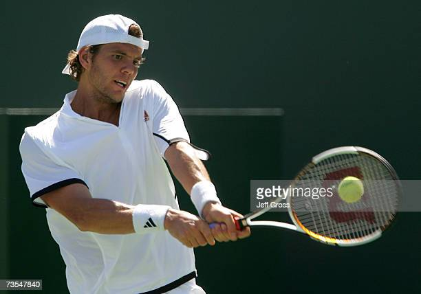 PaulHenri Mathieu of France returns to Mardy Fish at the Pacific Life Open on March 11 2007 at the Indian Wells Tennis Garden in Indian Wells...